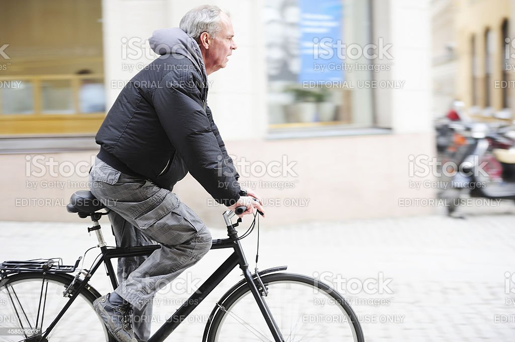 Old bicyclist i profile royalty-free stock photo