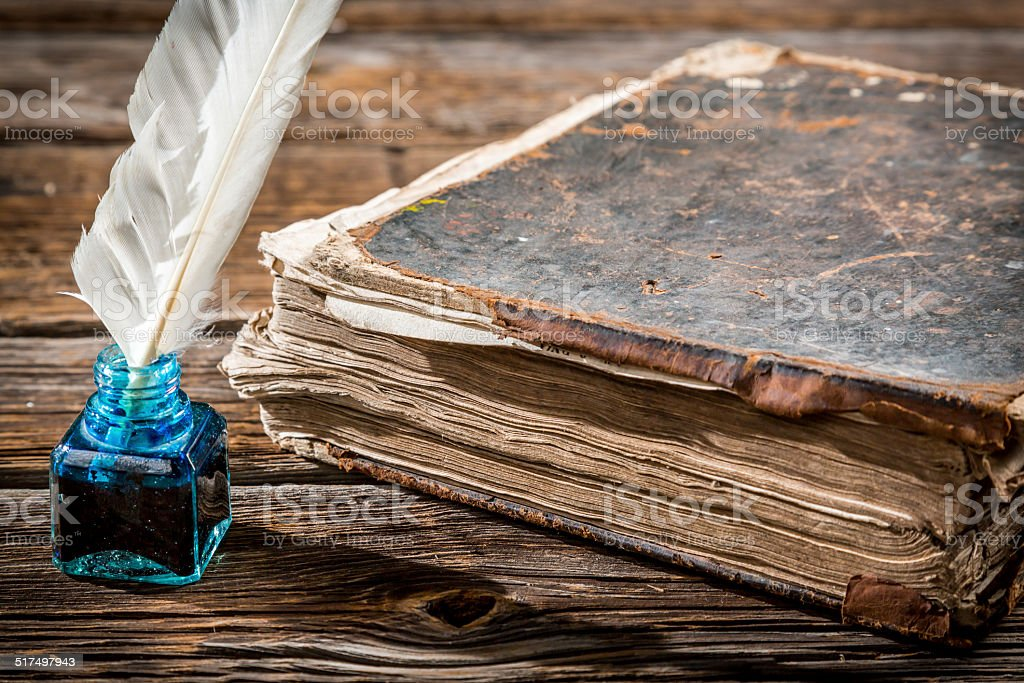 Old big book and pen with blue ink stock photo