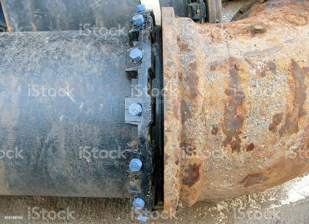 Old big drink water pipe joined with new pipe stock photo