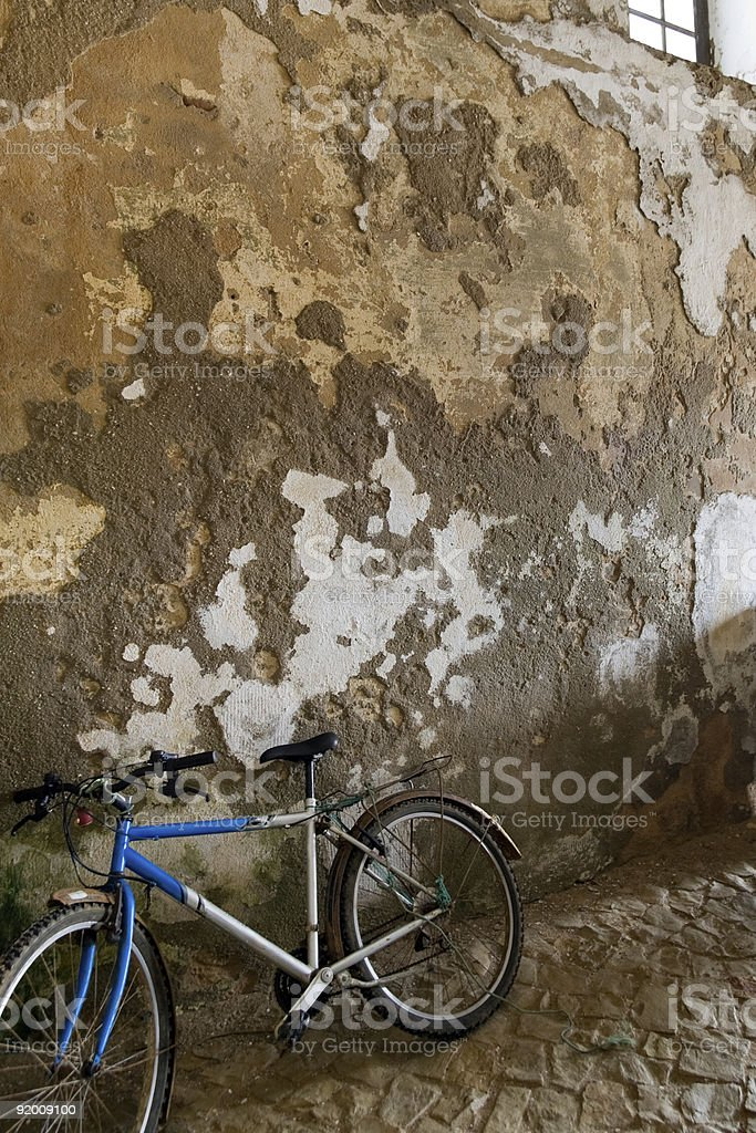 Old bike against wall royalty-free stock photo