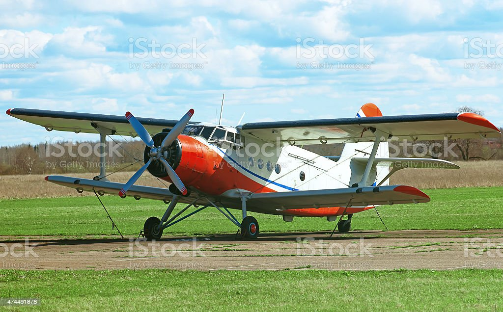 Old biplane aircraft in the airport. stock photo