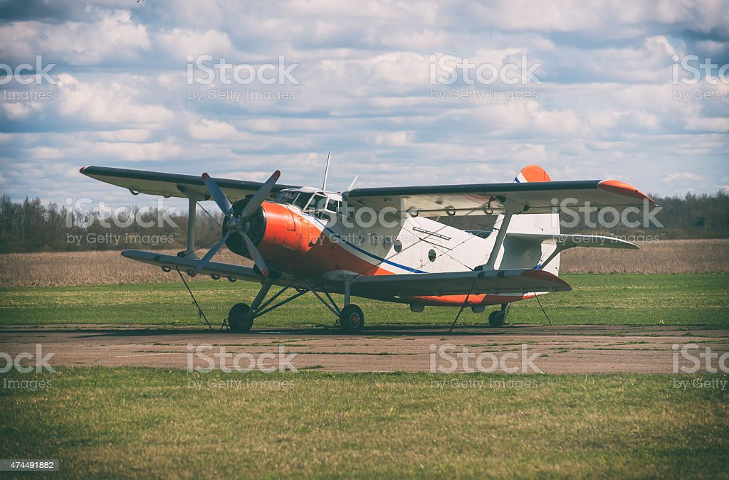 Old biplane aircraft in the airport. Vintage effect. stock photo