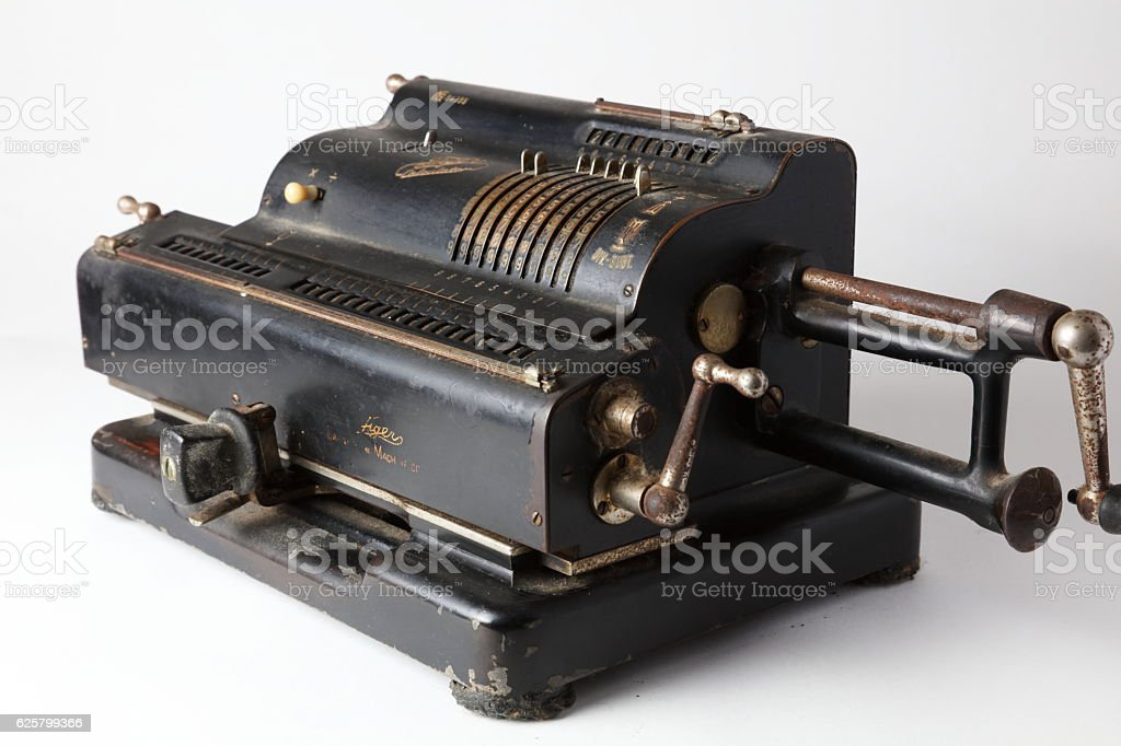 Old black adding machine isolated on white background stock photo