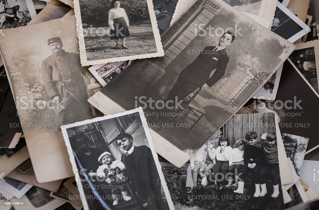Old black and white and sepia photos at flea market. stock photo