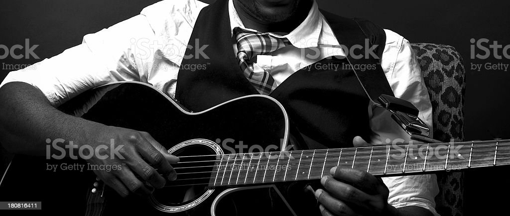 Old Black Blues Guitarist Playing Acoustic in monochrome black and...