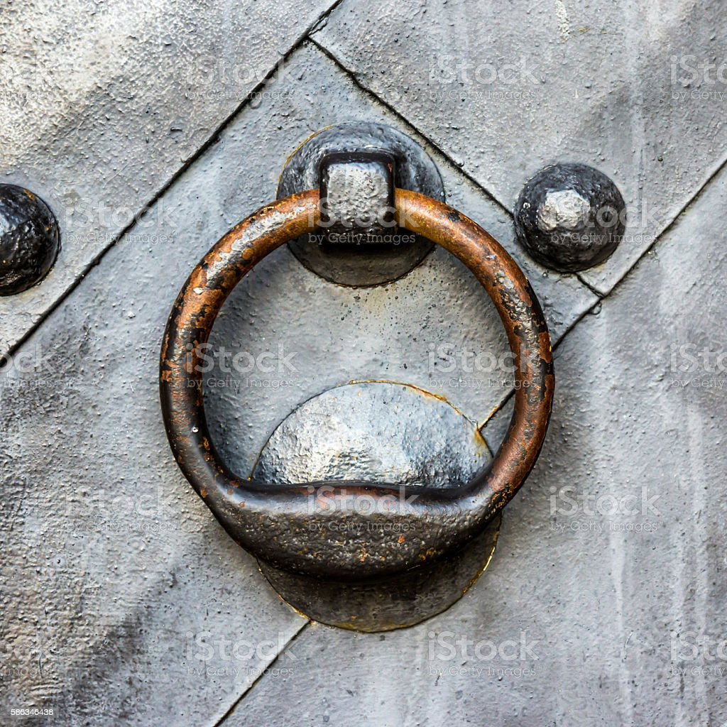 Old black door with ring knocker stock photo