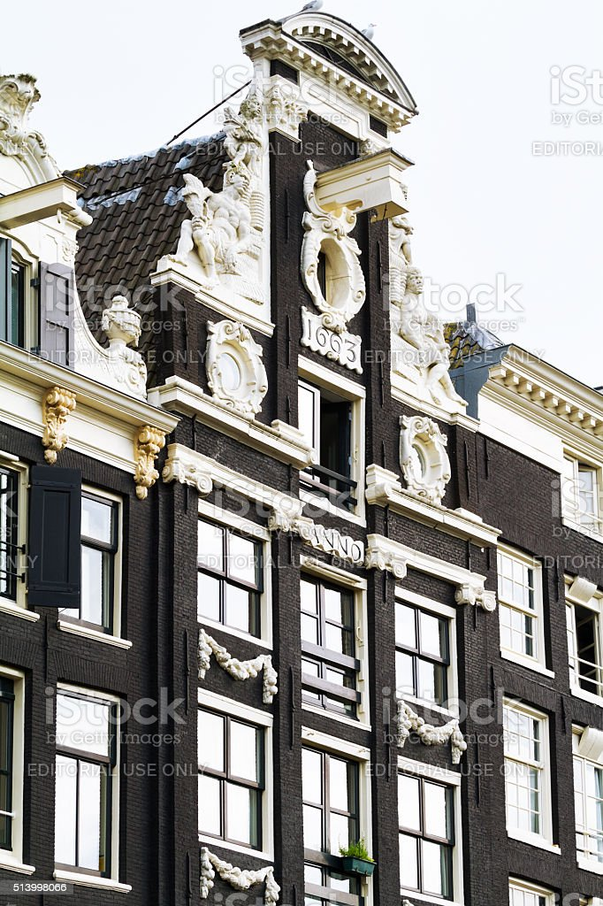 Old black facade in Amsterdam stock photo