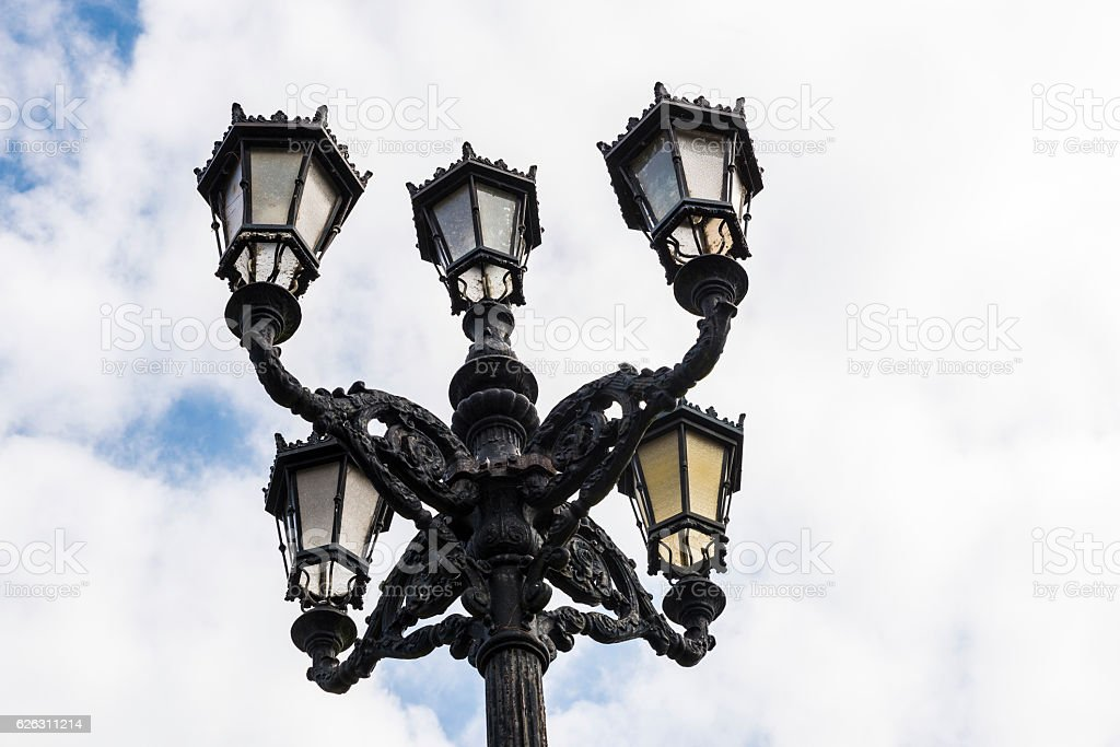 Old black lamppost with five lights stock photo
