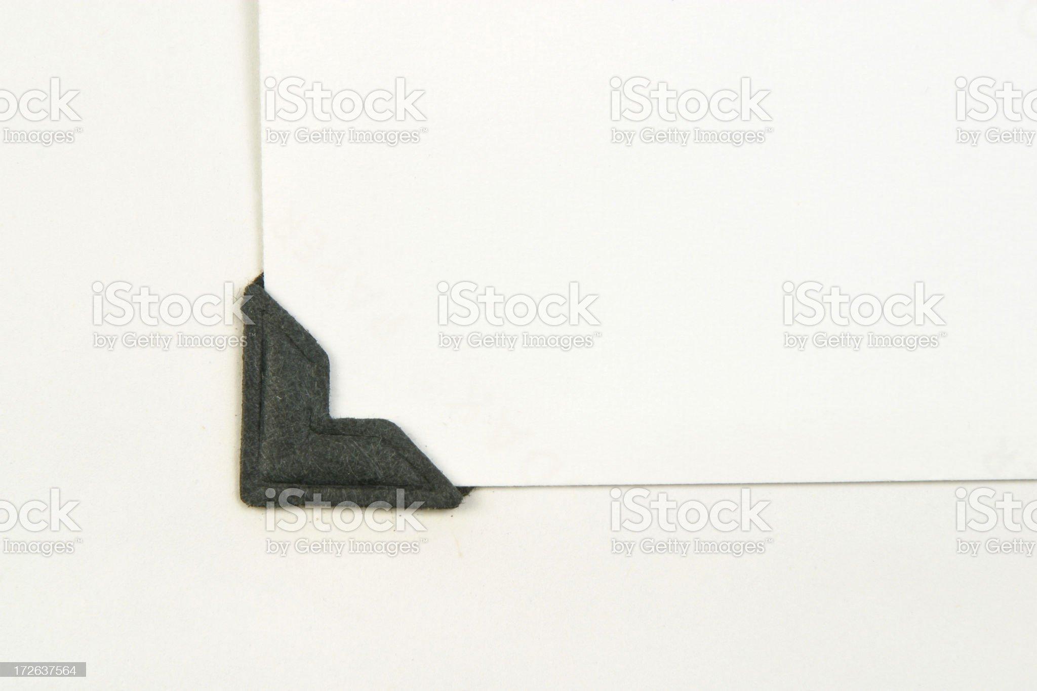 Old Black Photo Corners On Album Page royalty-free stock photo