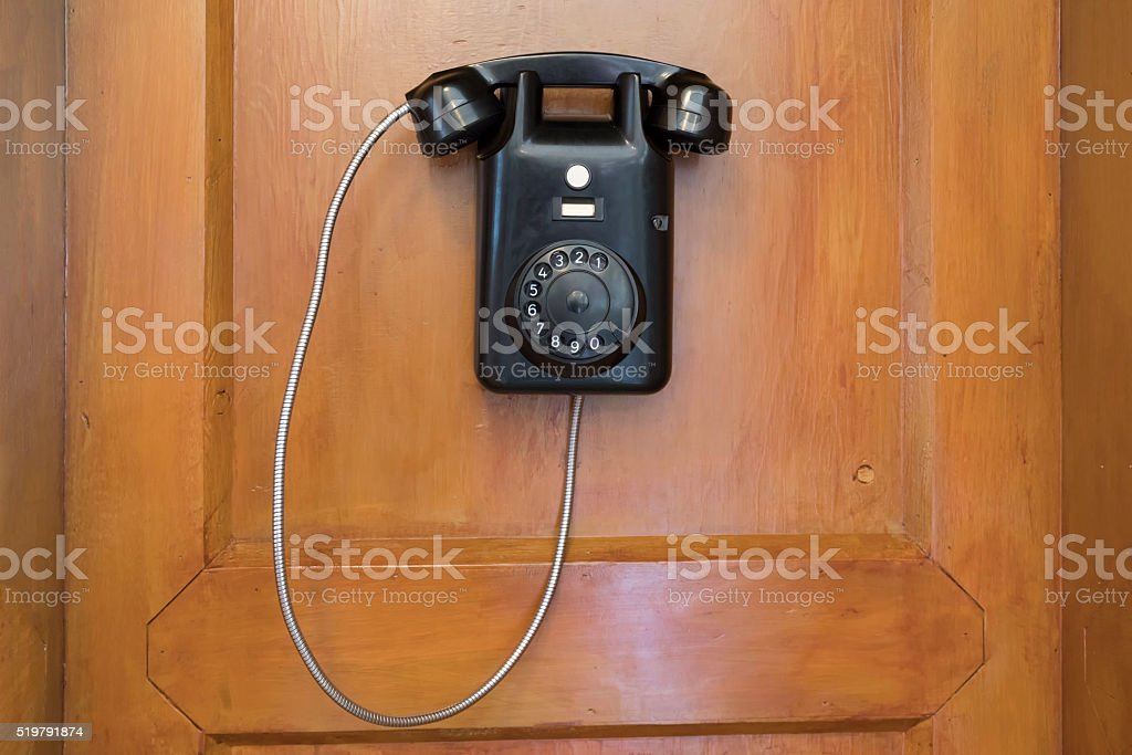 Old Black Telephone with Dial Plate stock photo