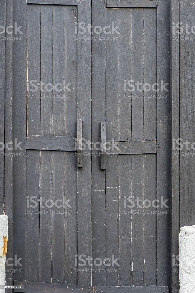 Old black wooden door stock photo