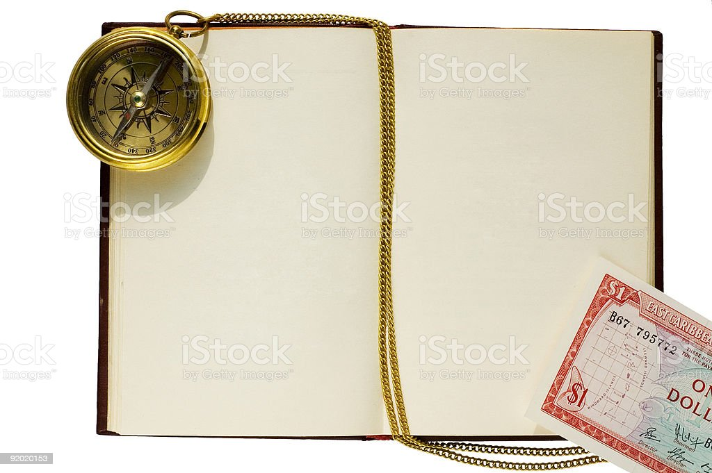 Old blank book with compass, chain, and caribbean dollar royalty-free stock photo