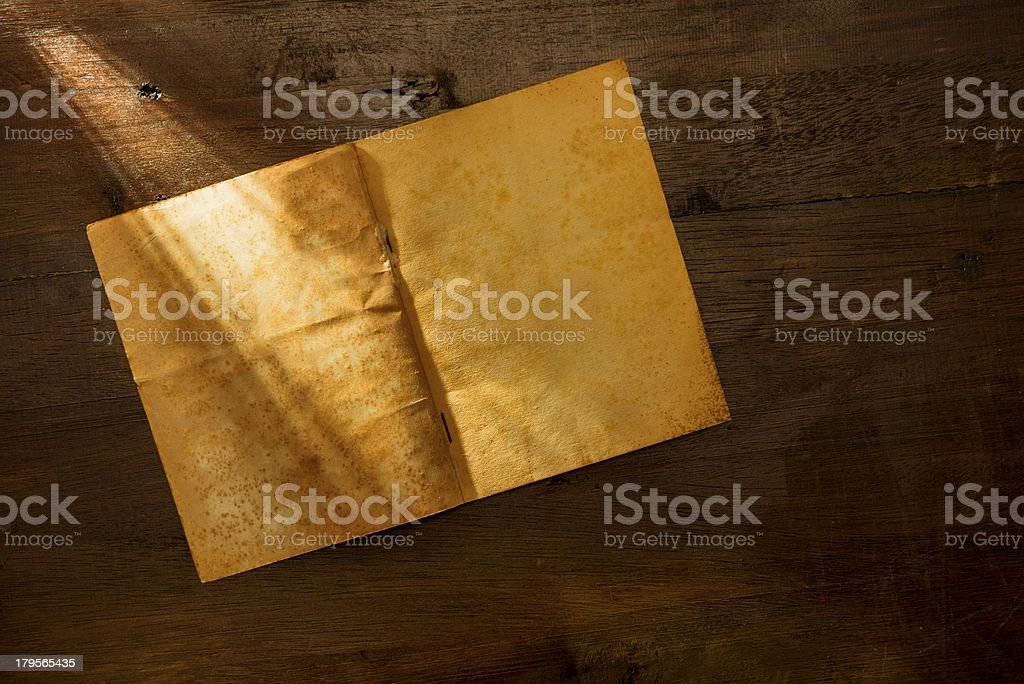 Old blank notebook on wooden background royalty-free stock photo