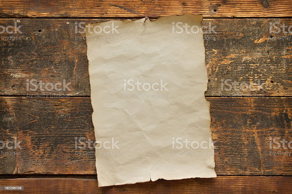 old blank paper nailed to a wooden door royalty-free stock photo