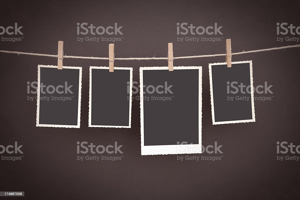old blank photos hanging on clothesline with clipping path royalty-free stock photo