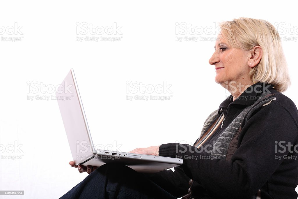 old blond woman and laptop royalty-free stock photo