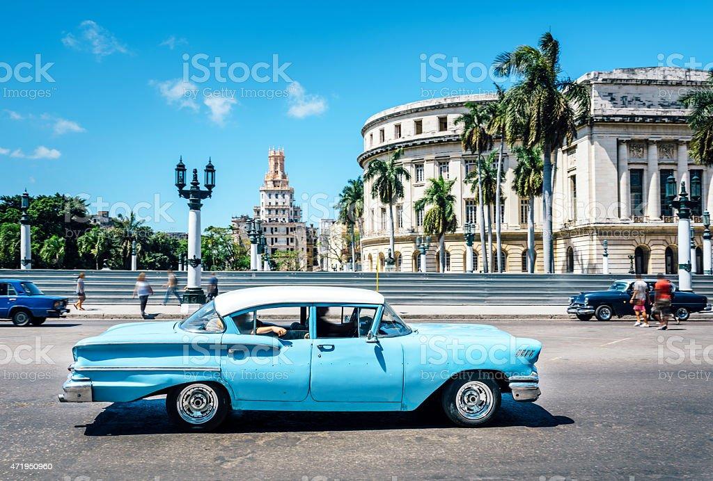 Old blue American car on Havana street, near Capitolio stock photo