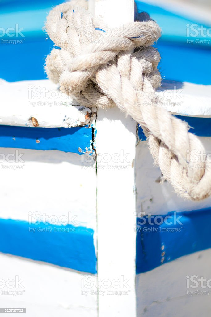 Old Blue and White Mediterranean Fishing Boat, Rope Knot (Detail) stock photo