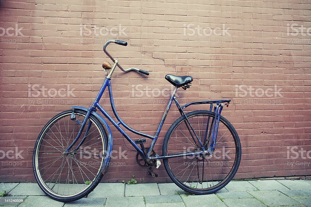 Old Blue Bicycle Wall Peeling royalty-free stock photo