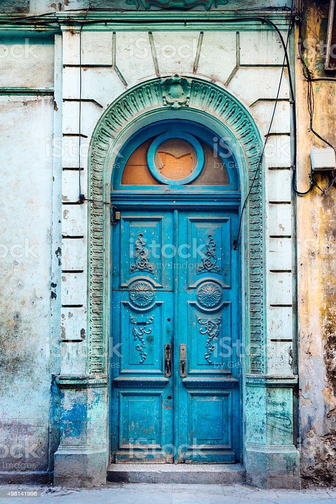 Old Blue Door in Havana, Cuba stock photo
