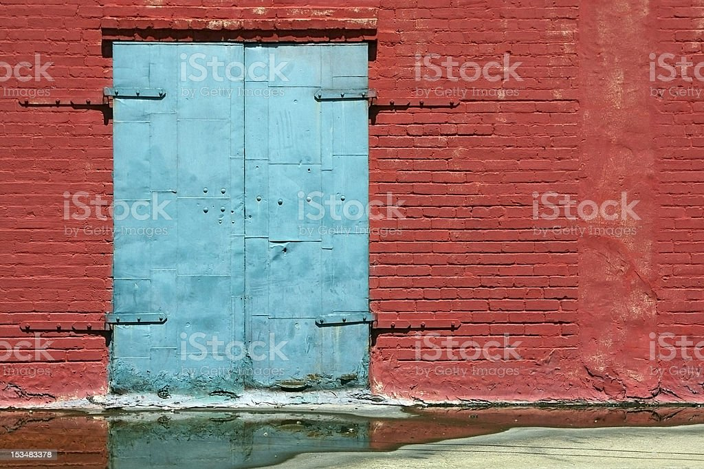 Old Blue Door with Red Brick Wall royalty-free stock photo
