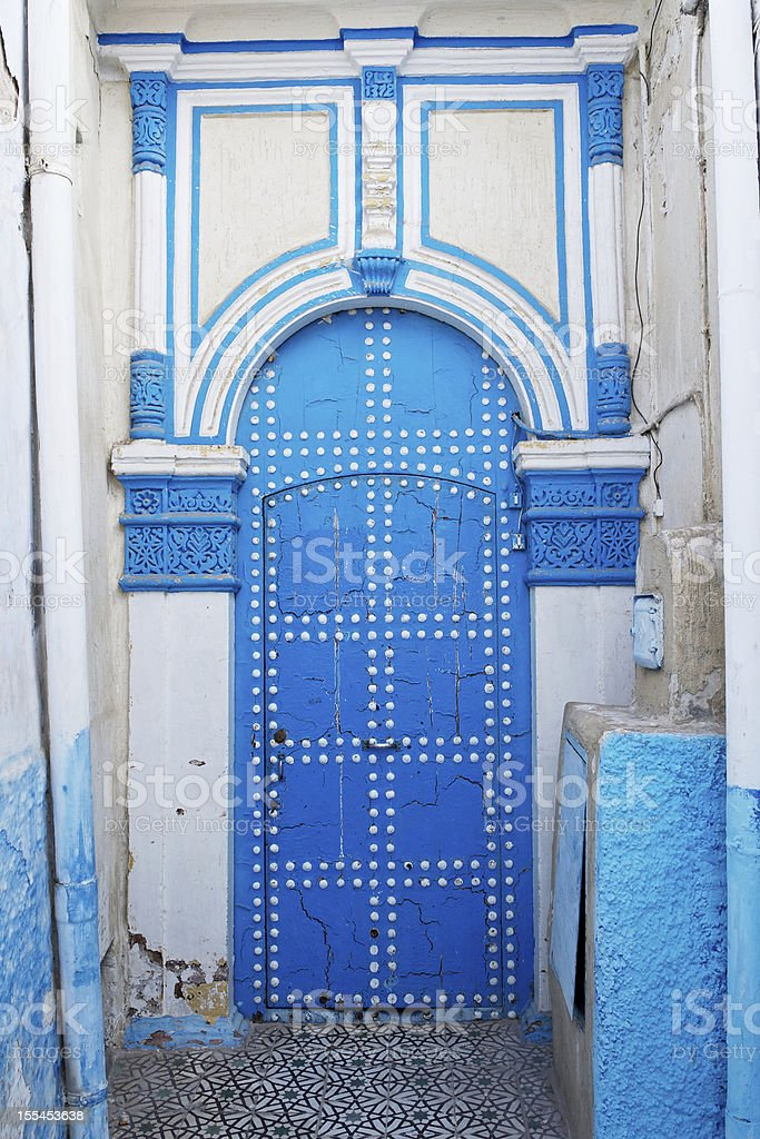 Old blue door with white studs, Rabat, Morocco royalty-free stock photo