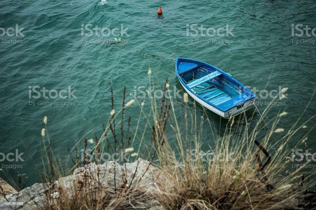 Old blue fishing boat stock photo