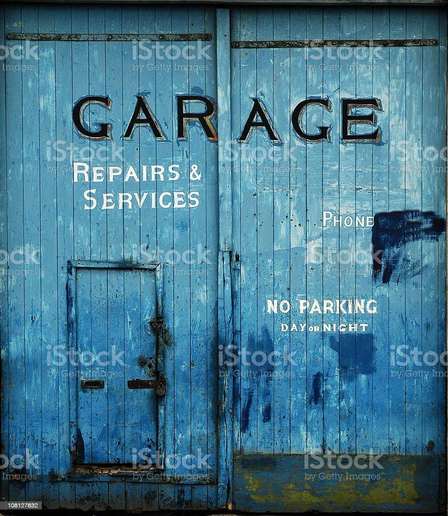 Old blue garage doors stock photo