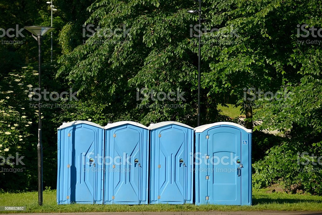 Old blue mobile toilet cabins stock photo