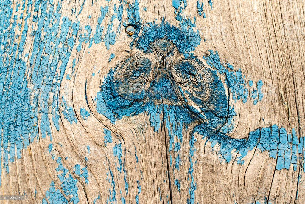 Old Blue Paint and Wood Knot stock photo