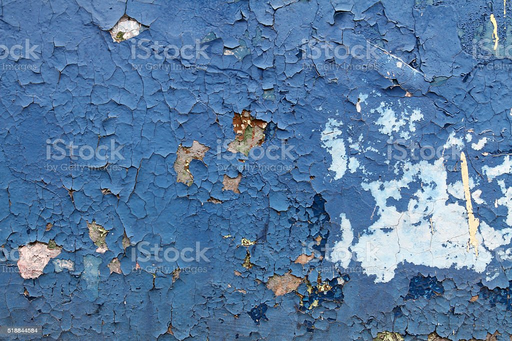 Old blue paint with cracks on the wall stock photo
