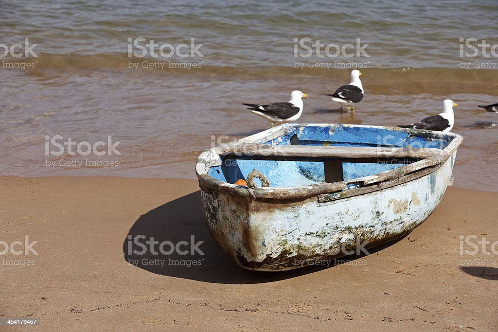 Old blue rowing boat on the beach royalty-free stock photo