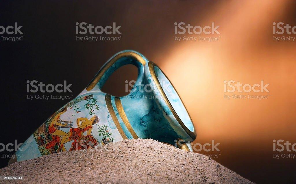Old blue vase in sands stock photo