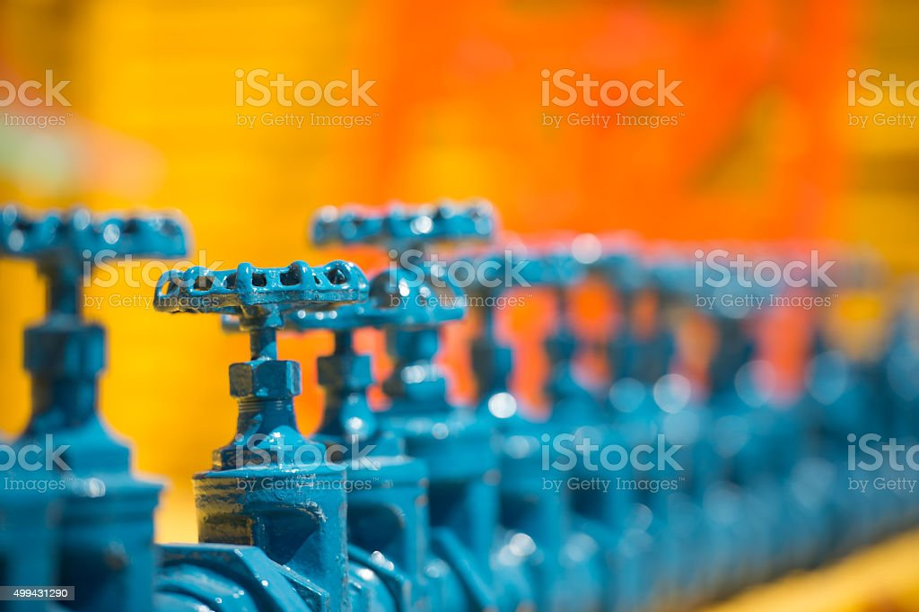 old blue water faucets stock photo