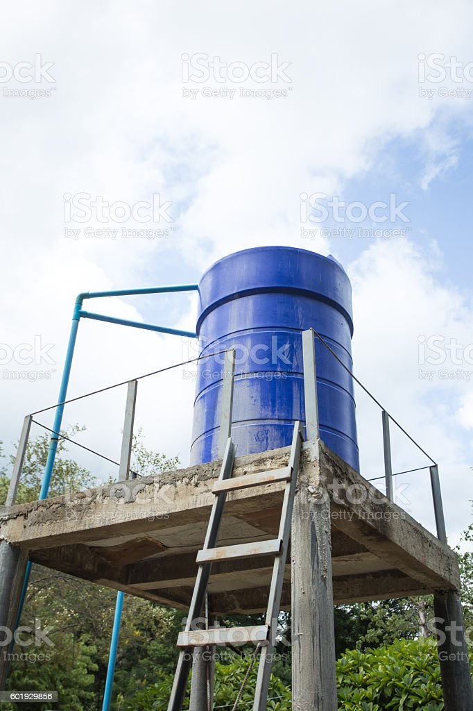 Old blue water tank in park. stock photo