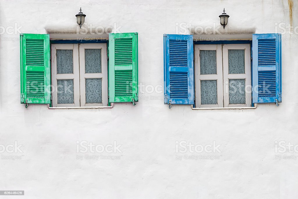 Old blue window and Old green window with white wall stock photo