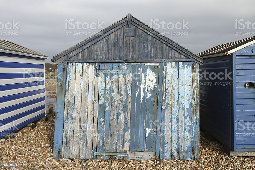 Old blue wooden beach hut on Hayling Island near Portsmouth royalty-free stock photo