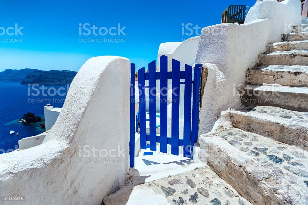 Old Blue Wooden Gate and Traditional Santorini Architecture stock photo