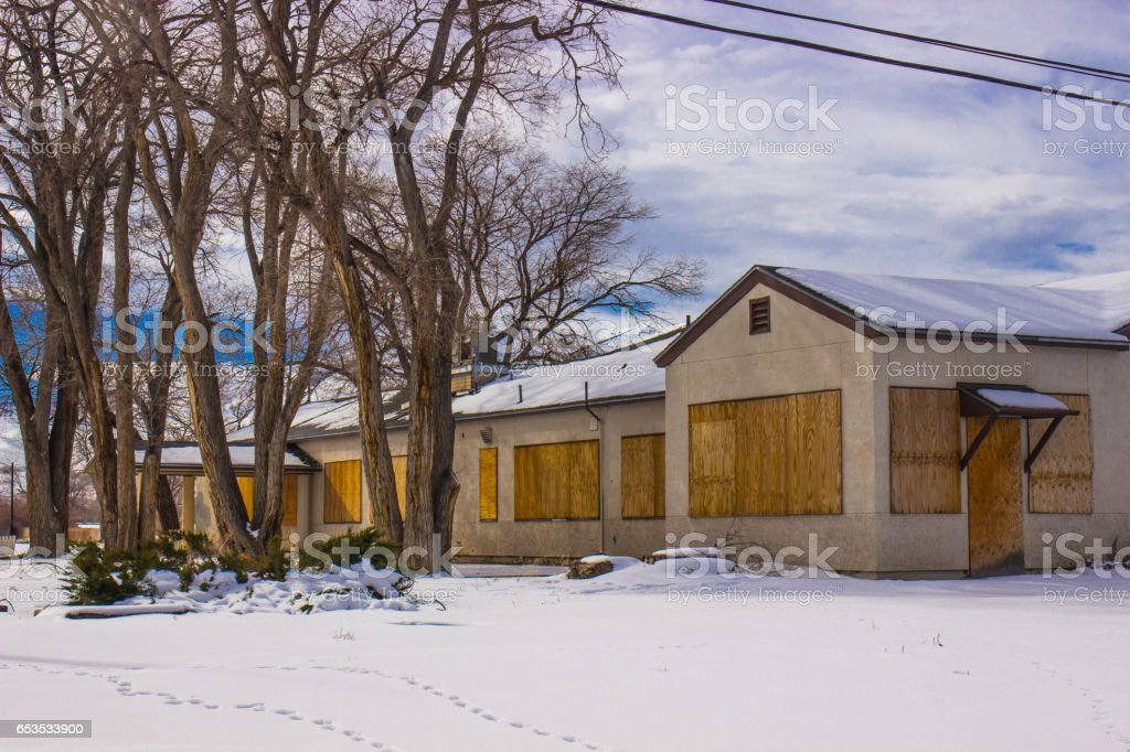 Old Boarded Up Commercial Structure in Winter stock photo