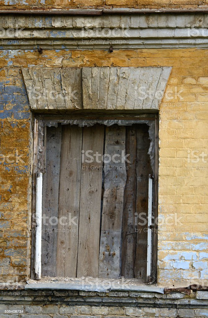 old boarded window stock photo
