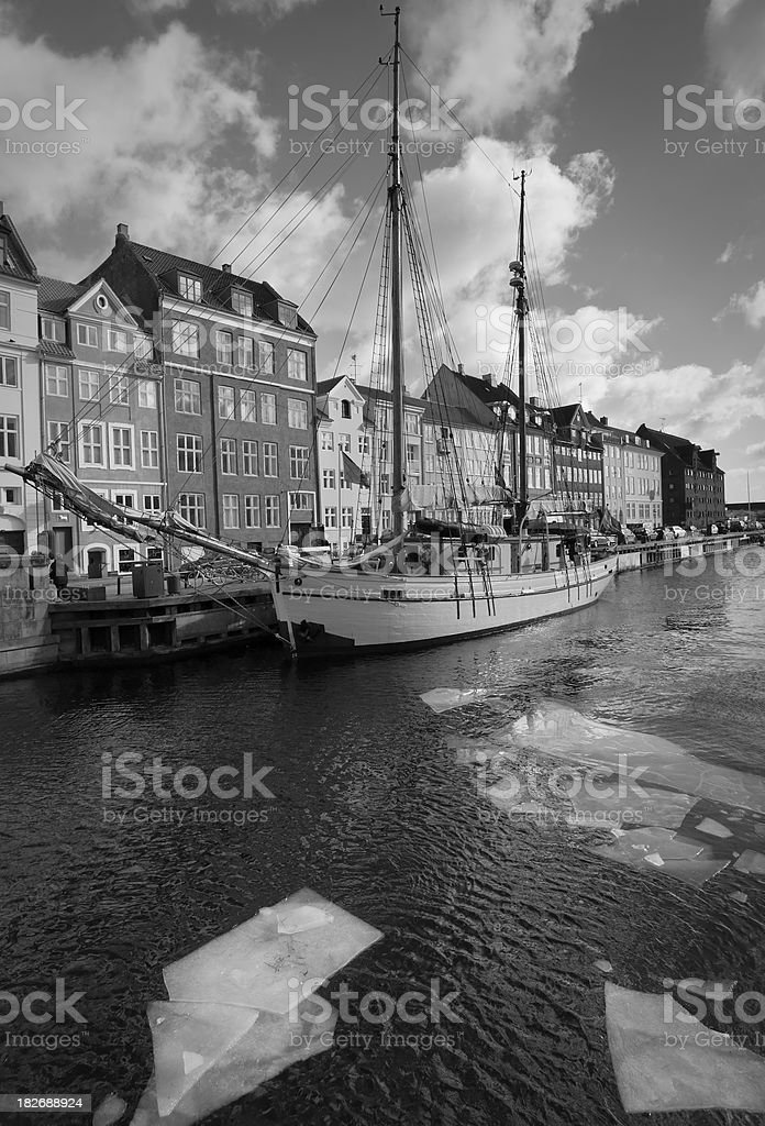 Old boat and houses in Copenhagen (Denmark) stock photo