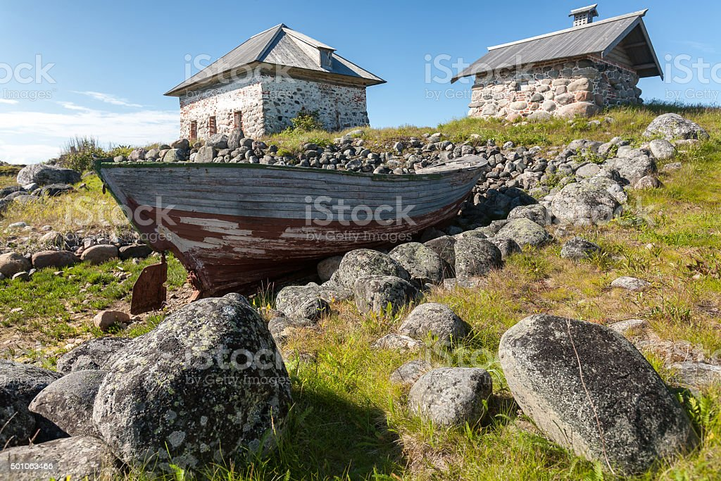 Old boat and stone houses. stock photo