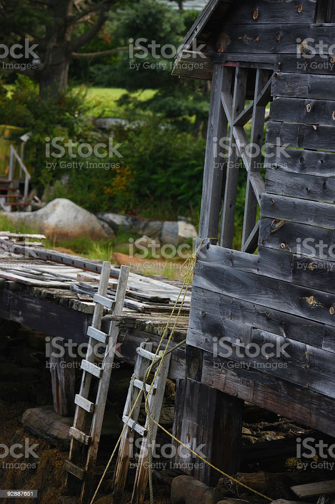 Old boat house weathered with time stock photo