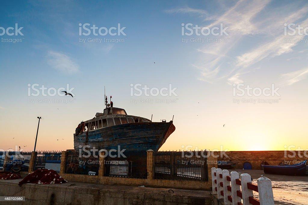 Old boat in harbor - Essaouira, Morocco stock photo