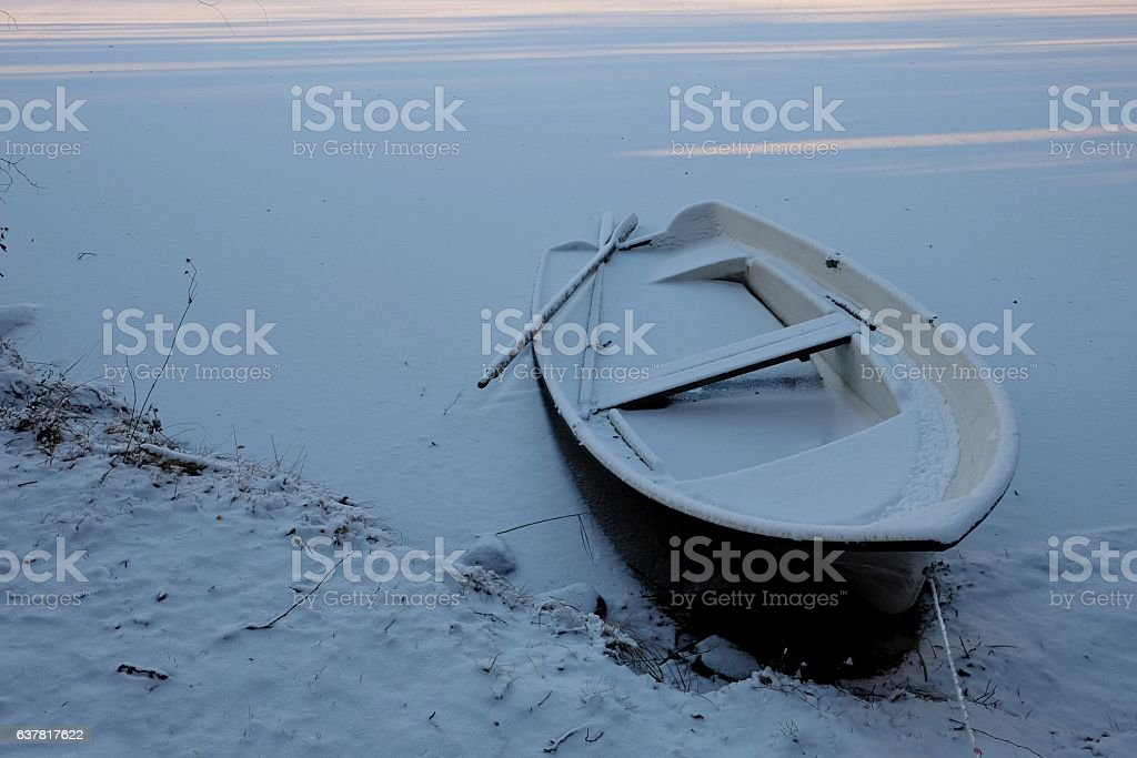 Old boat in the snow. stock photo