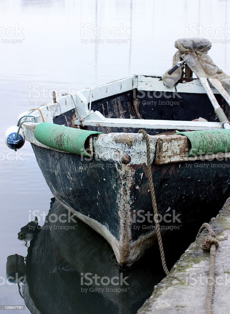 old boat in water stock photo
