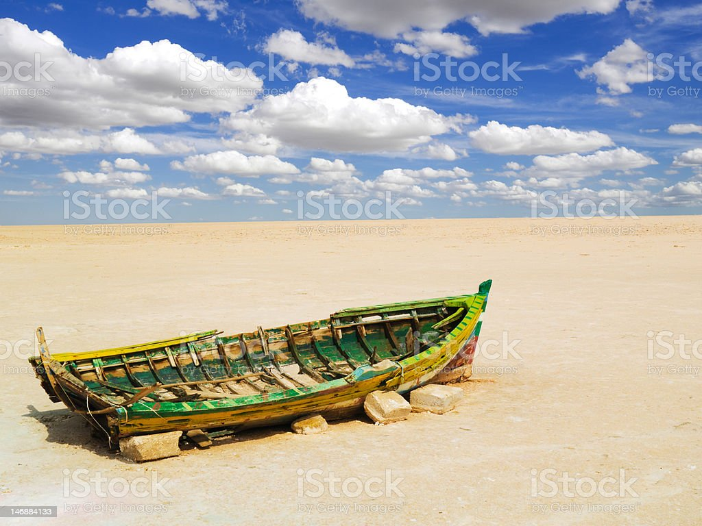 Old boat on a dry lake royalty-free stock photo