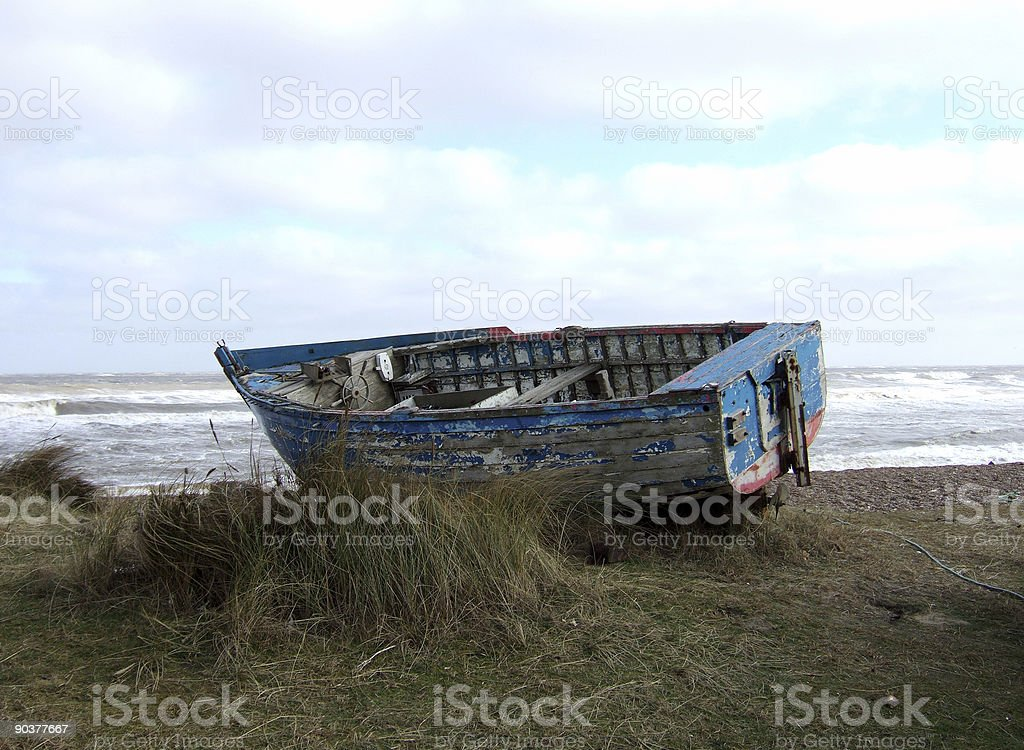 Old boat on beach stock photo