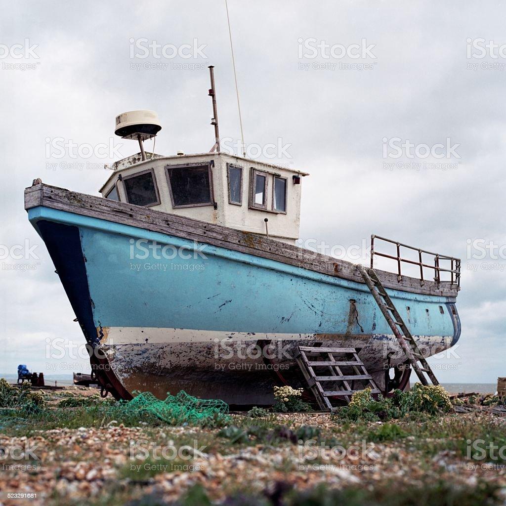 Old boat on English seaside stock photo