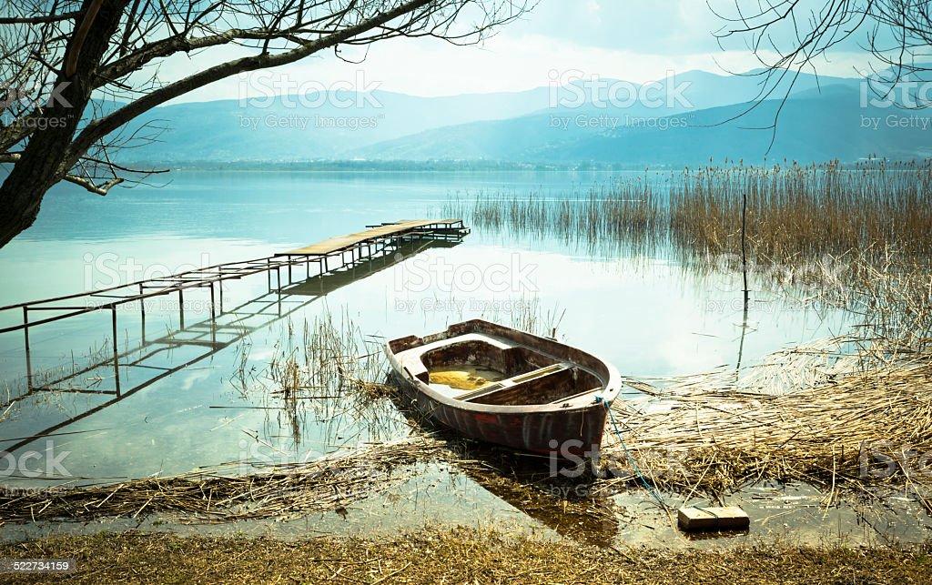 Old Boat on Lake stock photo